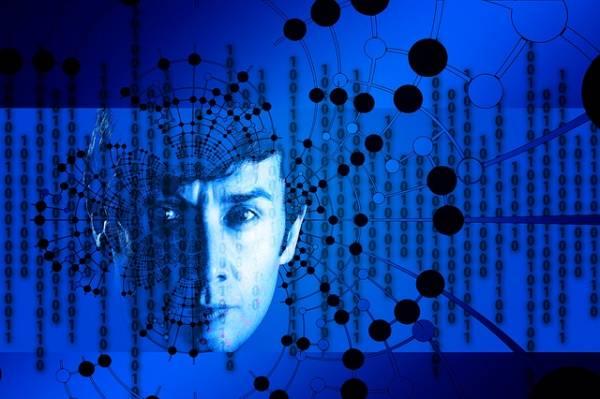 Un volto umano immerso in codici binari